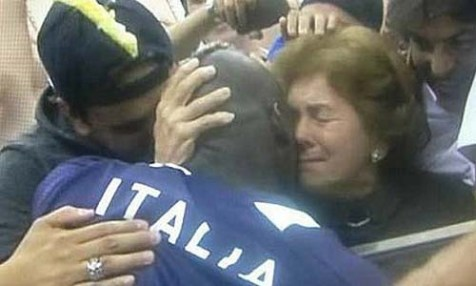 Italy&#039;s striker Mario Balotelli hugging his Jewish mother after bringing Germany to its knees last week.
