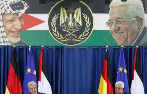Photo: Palestinian Authority banner showing the faces of Yassir Arafat and Mahmoud Abbas.
