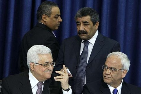 Palestinian president Mahmoud Abbas (L) sits next to Saeb Erekat, head of the PLO negotiation team with Israel.