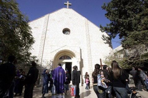 Palestinian Christians Standing outside the Latin Catholic Church after the expiration of their prayers in Gaza City