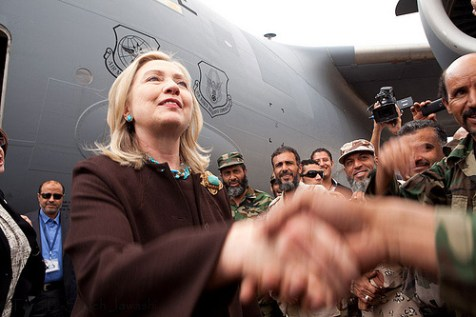 U.S. Secretary of State Hillary Rodham is greeted by Libyans upon arrival at Tripoli, October 18, 2011.