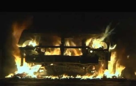 Benghazi's US consulate ablaze after Muslim protesters raided it, killing a worker.