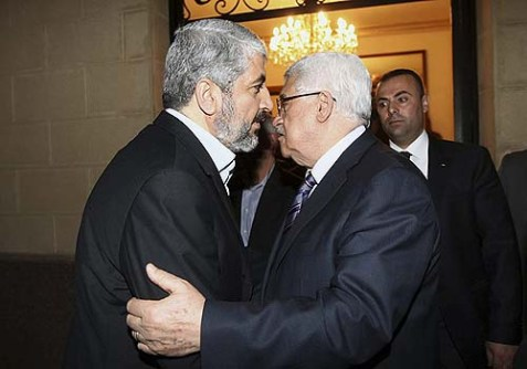 Palestinian President Mahmud Abbas meets with Palestinian Hamas leader Khaleed Meshaal in Cairo in February.