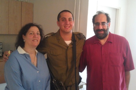 Newly inducted IDF paratrooper Akiva Goldstein and his parents in Akiva's apartment in Jerusalem, September 7, 2012.