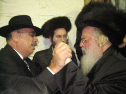 Munkatcher Rebbe dancing with Eli Isaac Vegh.