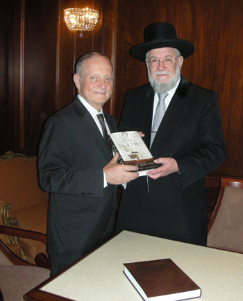 Rabbi Lau (right) with interviewer Daniel Retter.