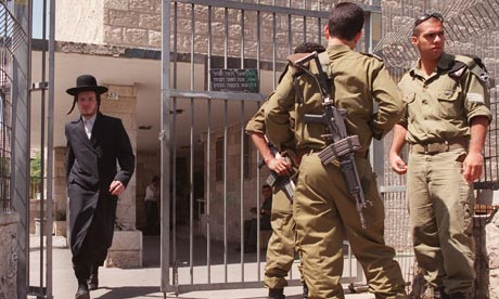Ultra-orthodox Jew walks past Israeli soldiers