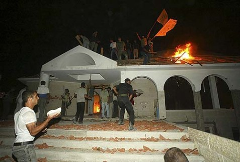 Peace at last: Palestinians celebrating the sanctity of the synagogue in Netzarim in the Gaza Strip after the IDF expelled the local Jewish families, September 12, 2005.