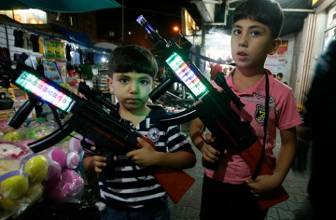 Gaza children buying toy weapons, August 16, 2012.