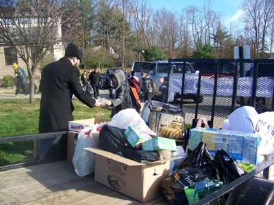 Rabbi Yakov Horowitz collecting donations from students. 