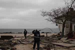 Volunteers assess the damage in Sea Gate, Brooklyn.