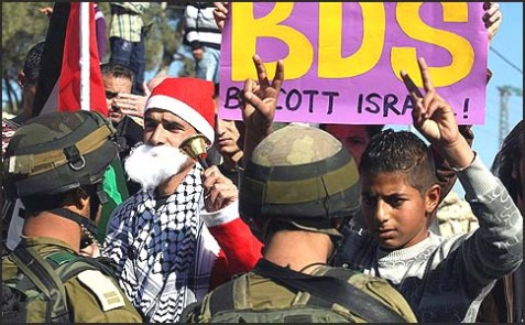 Israeli soldiers stand face-to-face with Palestinian protesters dressed as Santa Claus.