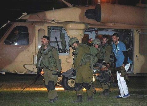 Wounded Israeli soldiers are wheeled into Soroka hospital in Beer Sheba November 10, 2012.