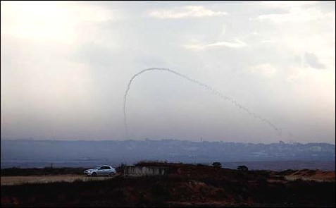 A trail of smoke is seen as a rocket is launched from the Gaza Strip towards the southern Israeli city of Sderot, November 11, 2012.