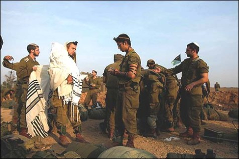 Israeli soldiers conducting morning service on the Gaza border, Monday, November 19, 2012.