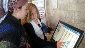 JewishPress.com reporter Malkah Fleisher voting.