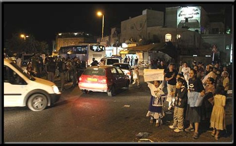 Jews (on the right) protested the stabbing, while Arabs (on the left) booed and ridiculed the protesters.