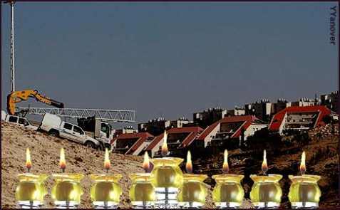 The town of Ma'aleh Adumim as seen from the E1 area, with menorah up front.