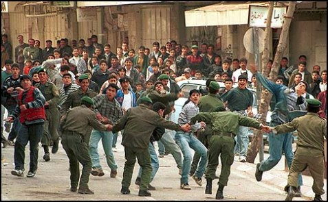 Back in 1998, these Palestinian policemen were trying to block the Arab mob from pelting Israelis with stones.