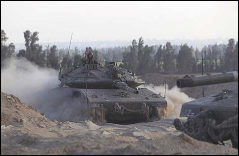 Israeli Markava tanks returning to thier base, after morning patrol near Gaza.