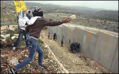 The barrier is keeping the folks pictured on the left from murdering the folks living on the other side.
