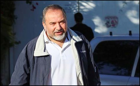Ex Israel&#039;s Foreign Minister Avigdor Liberman leaves his house at the settlement of Nokdim at the moment after he resigned from his duty.