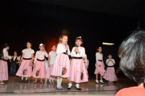 Girls perform in 1950s style at Highland Lakes Chabad celebration.