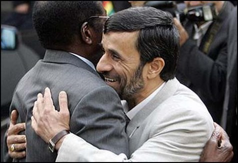 Zimbabwe's Robert Mugabe (L.) with a friend.