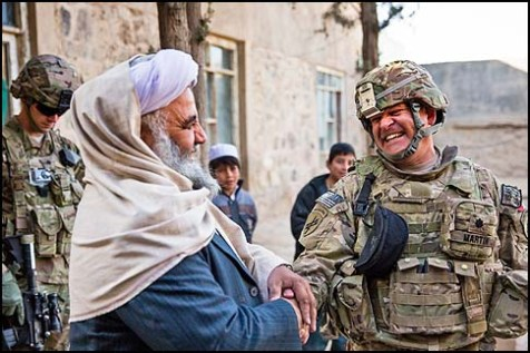 U.S. Army Lt. Col. Mark Martin shakes hands and laughs with Mawlawi Guhlam M. Ruhaani, at the conclusion of a key leader engagement in Farah City, Afghanistan, Dec. 29.