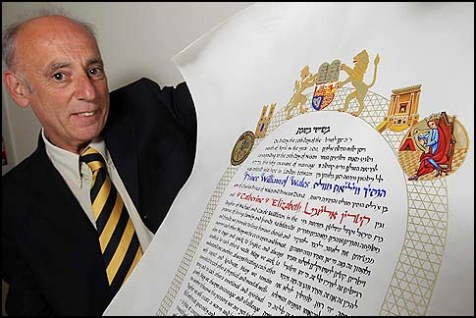 Artist Mike Horton holds up his hand-made ketubah which he made as a gift for British Prince William and his fiancee.