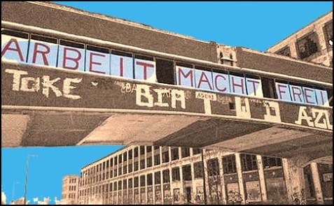"Someone hung a sign that says ""Arbeit Macht Frei"" over a Packard Plant in Detroit."