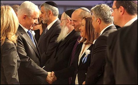 Israeli&#039;s Prime Minister Benjamin Netanyahu shaking hands with Labor party leader Shelly Yachimovich, who is flanked by Naftali Bennett to her right and Yair Lapid to her left.