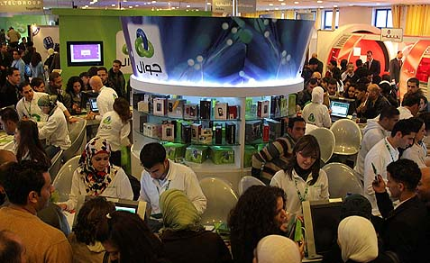 Palestinians attend the Technology Expotech, 2009, in Ramallah.