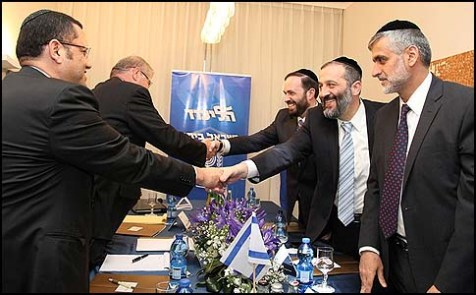 Shas party&#039;s ELi Yishai, Aryeh Deri and Ariel Atias in coalition talks with Likud.