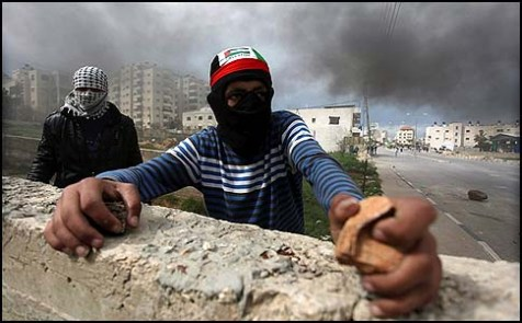 Here's a Palestinian minor preparing to hurl a stone at Israeli security forces. UNICEF condemns Israel for arresting minors like him, questioning them and, occasionally, speaking harshly to them.