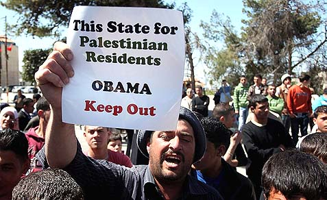 Palestinian demonstrators protest against the visit of US President Barack Obama last year.
