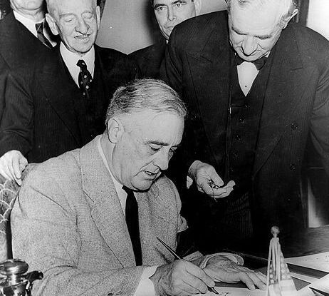 Franklin Roosevelt signing Declaration of War against Germany in 1941