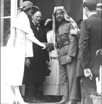 Lady Clementine Ogilvy Spencer-Churchill, wife of England's Secretary of State for the Colonies Sir Winston Churchill, shaking hands with the new Emir Abdullah of the newly created country of TransJordan. The year was 1921.Not seen in the picture are all the Jews from whose possession Sir Winston had just removed TransJordan.