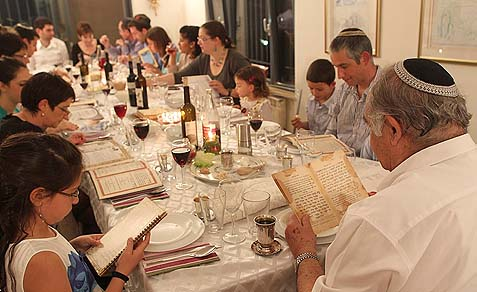 A family Pesach seder in Tzur Hadassah, Israel, April 6, 2012.