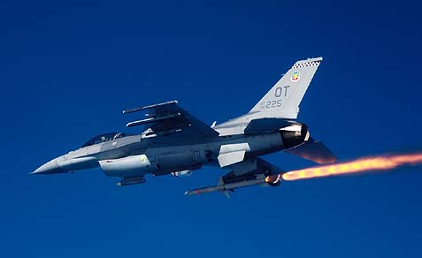 An F-16C Fighting Falcon firing an AGM-88 high-speed antiradiation missile at a target. The HARM is an air-to-surface missile designed to seek and destroy enemy radar-equipped air defense systems. The F-16 is the only aircraft in the Air Force capable of using the HARM.