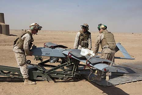 From left to right, U.S. Marine Corps Cpl.'s Joseph Bellevue, Robert M. Smith and Jeremy Perez, Marine Unmanned Aerial Vehicle (UAV) Squadron 3, load an RQ-7B UAV onto a launching ramp, in Camp Leatherneck, Helmand Province, Afghanistan. Photo by Lance Cpl. Robert R. Carrasco.