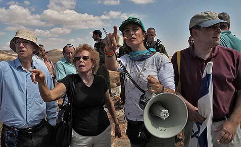 Nadia Matar (with megaphone).