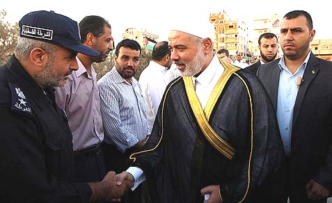 Hamas leader Ismail Haniya speaking with Arab security officers, before giving a speech on the first day of the Muslim holiday of Eid al-Adha.