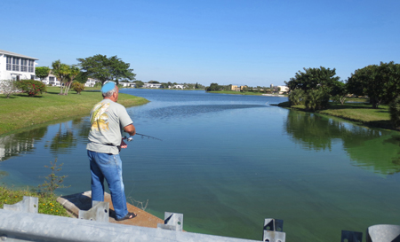 Fishing at the lagoon in the center of Century Village West Palm Beach.