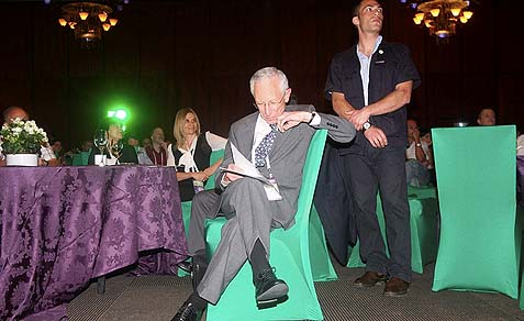 Bank of Israel Governor Stanley Fischer with his security man before delivering his farewell speech.