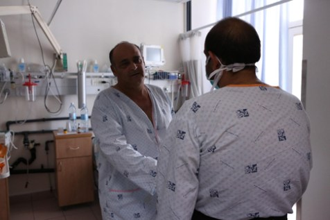 Transplant patients David Ben-Yair (left) and Muhammad Eckert meet after their operations (Piotr Fliter)