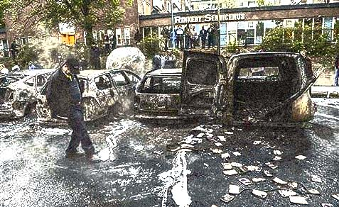 Burnt cars in the suburb of Rinkeby, outside Stockholm.