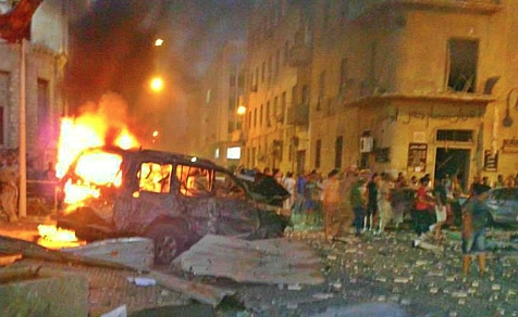 Benghazi, Libya Courthouse area in flames Sunday, July 28, day after massive prison break
