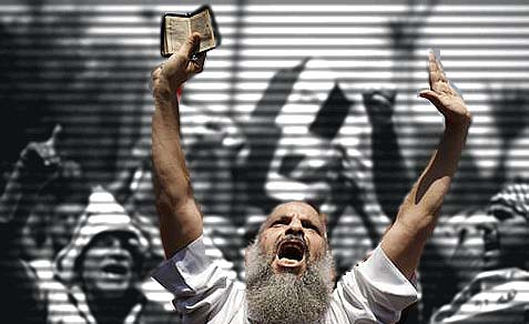 A pro-Morsi Morsi protester chanting slogans during a rally after Friday's prayers in Cairo, July 5, 2013.