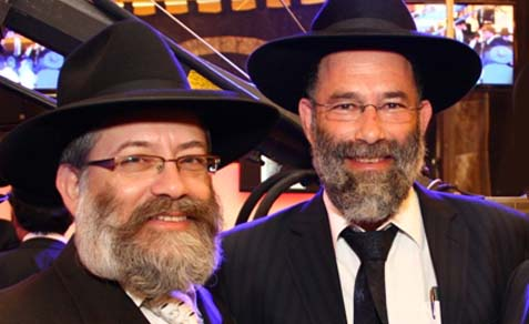 Col. (ret.) Rabbi Dov Povarsky (R.) with Haredi journalist David Argaman.